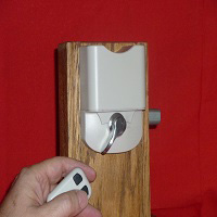 Remotizer Universal deadbolt adapter with Nickel thumb turn.